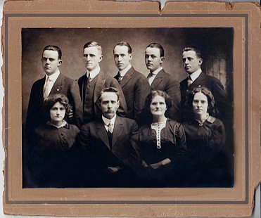 Dorothy Davis Stuck's father, Floyd Davis with his parents and siblings: (back row, left to right) Leven, Fletcher, Hughes, Roy, and Floyd; (front row) Ethel, Martin Luther, Mollie, and Myrtle; 1916 © Pryor Center for Arkansas Oral and Visual History, University of Arkansas