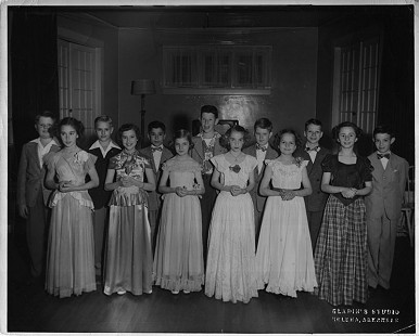 Jean Bussell (Sugg), 1st from left, at a 7th-grade ballroom dance; age 13 © Pryor Center for Arkansas Oral and Visual History, University of Arkansas