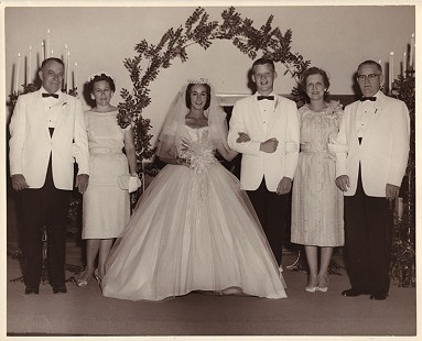 B. Alan Sugg and Jean Bussell Sugg on their wedding day at West Helena First Baptist Church; on left: Fulton and Virginia Simpson, Jean's stepfather and mother; on right: Louise and Barney Sugg, Alan's parents; June 8, 1960 © Pryor Center for Arkansas Oral and Visual History, University of Arkansas