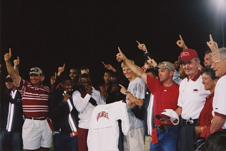 From the right: B. Alan Sugg, Jean Sugg, and John McDonnell with the University of Arkansas Track Team, June 2003 © Pryor Center for Arkansas Oral and Visual History, University of Arkansas