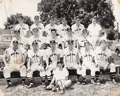 Bubba Sullivan (sitting on ground), batboy for the Wabash baseball team, and his father, Berbon Silas Sullivan (top row, 4th from left); Wabash, Arkansas, 1952 © Pryor Center for Arkansas Oral and Visual History, University of Arkansas