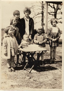 Buddy Sutton (seated) on his first birthday with his sister, Sue Sutton; cousin, Mary Jim Sutton; cousin, Geraldine Phillips; cousin, Jeanette Sutton; sister, Roxie Sutton; Hope, Arkansas, 1932 © Pryor Center for Arkansas Oral and Visual History, University of Arkansas