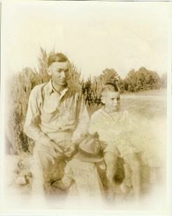 Buddy Sutton with his father, Claud Sutton, on Experiment Station Road; Hope, Arkansas, 1937 © Pryor Center for Arkansas Oral and Visual History, University of Arkansas