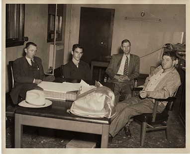 "Buddy Sutton's father, Sheriff Claud Sutton (left), with an unknown man; the prosecuting attorney, James Pilkington; and Herald ""Pod"" Porterfield; Hope, Arkansas, ca. 1950 © Pryor Center for Arkansas Oral and Visual History, University of Arkansas"