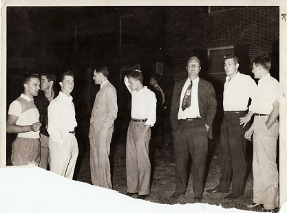 Buddy Sutton (2nd from right) with Coach Otis Douglas (3rd from right); University of Arkansas, Fayetteville, Arkansas; November 17, 1952 © Pryor Center for Arkansas Oral and Visual History, University of Arkansas