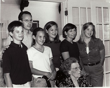 Buddy Sutton's family: (left to right) grandson, Michael Kirkpatrick; son-in-law, Dan Kirkpatrick; Rebecca Kirkpatrick; Mary Kirkpatrick; daughter, Becky Sutton Kirkpatrick; Katie Kirkpatrick; (seated) mother, Tena Sutton; 1996 © Pryor Center for Arkansas Oral and Visual History, University of Arkansas