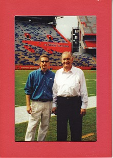 Buddy Sutton (right) on Florida Gators football field; University of Florida, Gainesville, Florida © Pryor Center for Arkansas Oral and Visual History, University of Arkansas