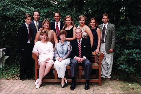 Buddy Sutton (seated, far right) with his family: (standing, left to right) Michael Kirkpatrick, Dan Kirkpatrick, Mary Sutton, Richard Sutton, Mary Kirkpatrick Doddridge, Katie Kirkpatrick, Rebecca Kirkpatrick, Wes Sutton, (seated, left to right) Becky Kirkpatrick, Peggy Sutton, Buddy Sutton; 2000 © Pryor Center for Arkansas Oral and Visual History, University of Arkansas