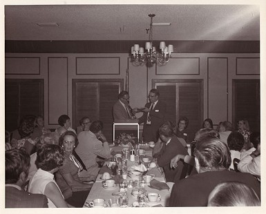 Floyd Thomas receiving a plaque at his retirement banquet © Pryor Center for Arkansas Oral and Visual History, University of Arkansas