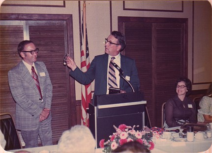 Floyd Thomas receiving a watch at his retirement banquet © Pryor Center for Arkansas Oral and Visual History, University of Arkansas