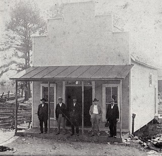 Building in Prattsville built in 1911; located across the road from the general store later operated by Albert and Helen Stephens; builders pictured from left to right: Mr. Allen; Mr. Bob Allen, son; Mr. Sanford; Mr. Andrew York; and Dr. C. F. Cole  © Pryor Center for Arkansas Oral and Visual History, University of Arkansas