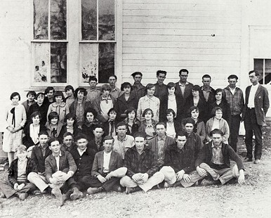 "Prattsville High School Class of 1924-25; last row, fifth from right: Wilton ""Witt"" Stephens; third row, fourth from right: Wilma Stephens; others pictured include Principal Brother Will Dougan, Milburn Keedy, Louis Barnett, Vernon Hope, Paul Pumphrey, Vivian Kemp, Beulah Irvin, Rommie Glover, Bill Halbert, Rommie Benning, John Cole, Calvin Ritchie, Jim Bob Dougan, Babe Benning, Iro Keesee, Sherman Hope, Walter Pumphrey, Christine Keesee, and Imogene Hope © Pryor Center for Arkansas Oral and Visual History, University of Arkansas"