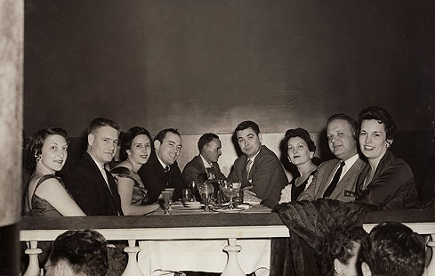 John D. and Robin Trimble with his sisters and their husbands: (from left) Mary Trimble Maier and John L. Maier Jr.; Robin Berry Trimble and John D. Trimble Jr.; unknown man at next table; Jack P. Mabray and Bettie Trimble Mabray; T. Arnold Turner Jr. and Jean Trimble Turner; the Blue Room at the Roosevelt, New Orleans, ca. 1957  © Pryor Center for Arkansas Oral and Visual History, University of Arkansas