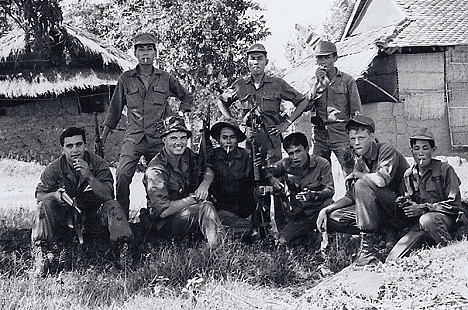 Jim Guy Tucker (front row, 2nd from left), Vietnam, 1965 © Pryor Center for Arkansas Oral and Visual History, University of Arkansas