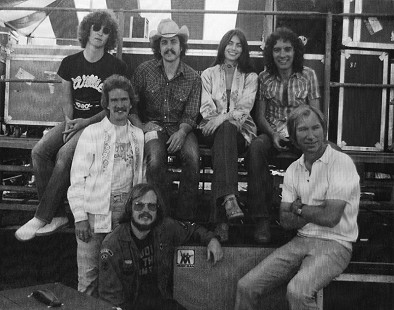 John Ware (standing at left) with Emmylou Harris and the Hot Band and Albert Lee (sitting top right), 1977 © Pryor Center for Arkansas Oral and Visual History, University of Arkansas