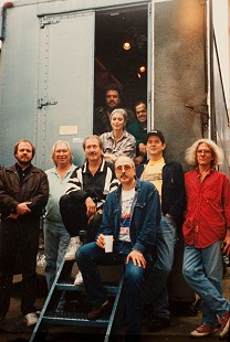 Enactron Truck studio session with the Hot Band and engineers: (1st row) Hank DeVito; (2nd row) Emory Gordy Jr., Glen D Hardin, James Burton, Rodney Crowell, John Ware; (3rd row) Emmylou Harris; (4th row) Brian Ahern, Donovan Cowart; 1995 © Pryor Center for Arkansas Oral and Visual History, University of Arkansas