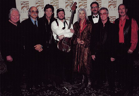 The Hot Band at the 2005 ASCAP Awards: (from left) Glen D Hardin, Hank DeVito, Rodney Crowell, Emory Gordy Jr., Emmylou Harris, Jed Hilly, John Ware, James Burton © Pryor Center for Arkansas Oral and Visual History, University of Arkansas