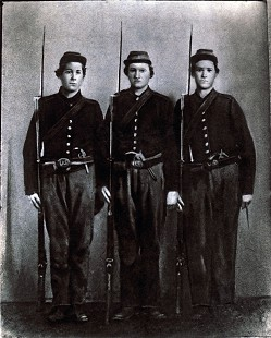 "Bud Whetstone's maternal great-great-grandfather, Mathias Nesbitt (center), with his brothers, Jim (left) and John, 30th Regiment, Indiana Union Army, Civil War; note on front of the picture indicates John was killed in the ""Battle of the Woods,"" and Mathias and Jim survived the war © Pryor Center for Arkansas Oral and Visual History, University of Arkansas"