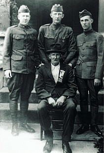 Bud Whetstone's great-great-grandfather, Mathias Nesbitt, with his sons and Lloyd Dill, great-uncle of Bud Whetstone, in World War I uniforms © Pryor Center for Arkansas Oral and Visual History, University of Arkansas