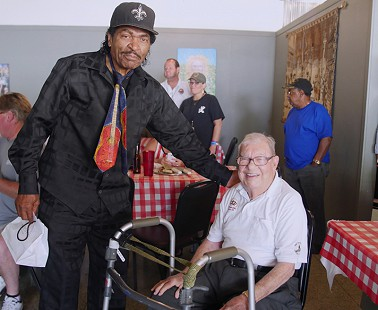Bobby Rush (left) with Sonny Payne at the Bobby Rush Appreciation Day event, which was held at Southbound Pizza during the King Biscuit Blues Festival; Helena, Arkansas, 2016 © Pryor Center for Arkansas Oral and Visual History, University of Arkansas