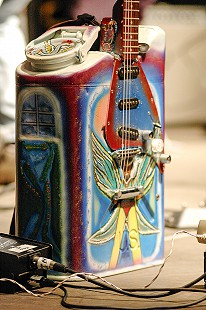 "Close-up of a customized gas-can guitar onstage during a performance by James ""Super Chikan"" Johnson at the Arkansas Blues and Heritage Festival; 2006 © Eric Gorder 2006; egorder@gmail.com"