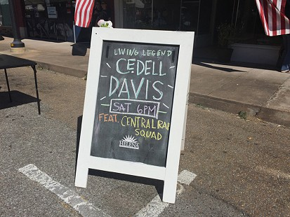 Signboard on Cherry Street advertising an upcoming performance by Cedell Davis during the King Biscuit Blues Festival; Helena, Arkansas, 2015 © Pryor Center for Arkansas Oral and Visual History, University of Arkansas