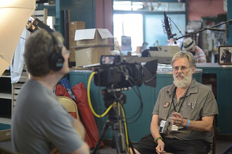 Don Wilcock (right) being interviewed by Scott Lunsford during the King Biscuit Blues Festival; 2015 © Eric Gorder 2015; egorder@gmail.com