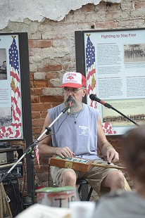 Unidentified musician on Cherry Street during the King Biscuit Blues Festival; 2015 © Eric Gorder 2015; egorder@gmail.com