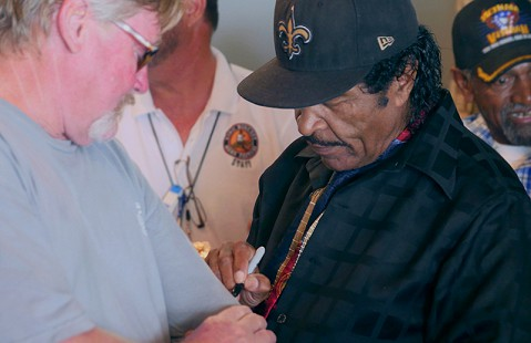 Bobby Rush signs autographs at the Bobby Rush Appreciation Day event, which was held at Southbound Pizza during the King Biscuit Blues Festival; Helena, Arkansas, 2016 © Pryor Center for Arkansas Oral and Visual History, University of Arkansas