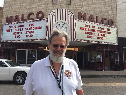 Don Wilcock in front of the historic Malco Theater on Cherry Street during the King Biscuit Blues Festival; Helena, Arkansas, 2015 © Pryor Center for Arkansas Oral and Visual History, University of Arkansas