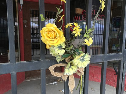 Flowers at the front door of the Gist Music Store; King Biscuit Blues Festival; Helena, Arkansas, 2015 © Pryor Center for Arkansas Oral and Visual History, University of Arkansas