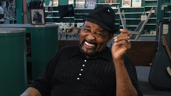 "Still frame from Pryor Center video interview with James ""Super Chikan"" Johnson at Bubba's Blues Corner during the King Biscuit Blues Festival; Helena, Arkansas, 2015 © Pryor Center for Arkansas Oral and Visual History, University of Arkansas"