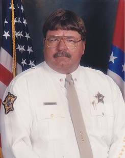 Jim Wozniak wearing the new insignia of rank of major of the Bella Vista Division of the Benton County Sheriff's office, December 25, 2005 © Pryor Center for Arkansas Oral and Visual History, University of Arkansas